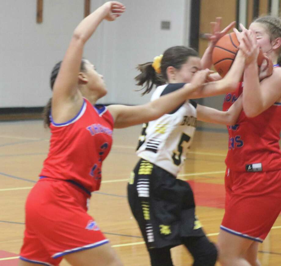 Lots of arms contest possession of this ball, but Bonnette Junior High's Peyton Collier finds herself in the middle of the trouble. Thompson was called for the foul on the play. Photo: Robert Avery