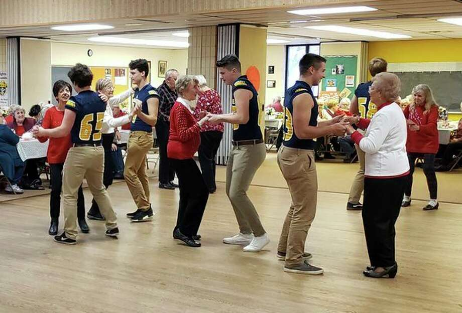 Manistee High School's football players joined the fun at Monday's Jingle Bell Ball. Music and dancing was the order of the day, and each player fell into step with a smile. (Courtesy photo)