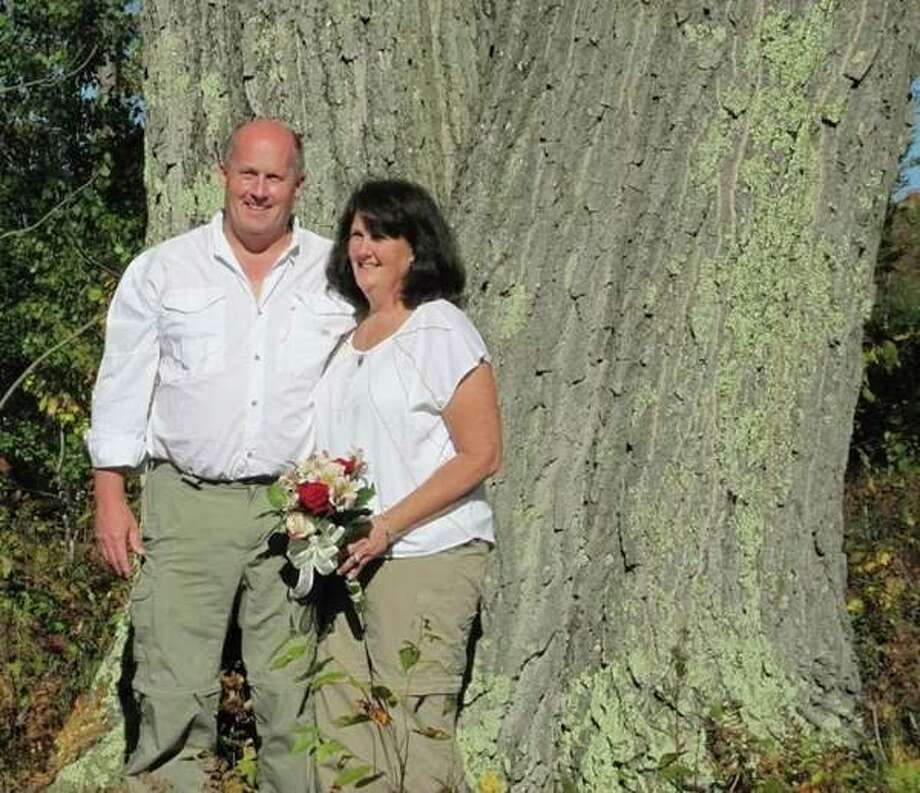 A couple poses in front of the largest tree in Michigan. (Photo provided)