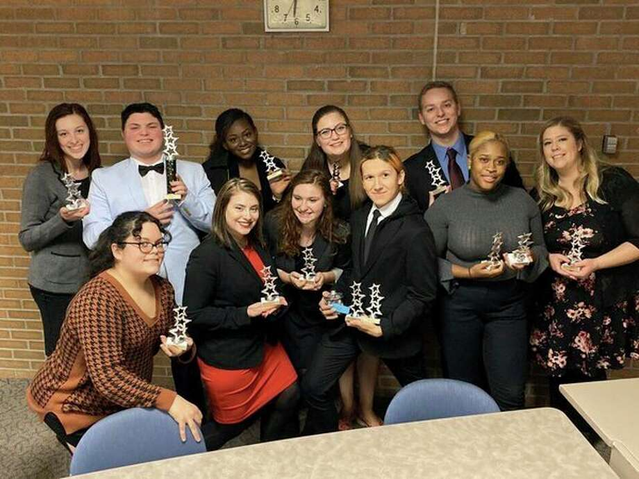 Members of the SVSU forensics team pose with their trophies following the Dec. 7 competition hosted at SVSU. Back row, from left: Jessica Carpenter, Isaiah Powell, Simone Vaughn, Savannah Senyk, and Justin Russell. Front row, from left: Sara Vasquez, Mikayla Rigda, Hannah Ducolon, Austin Teeple, Imani Clark, and Lydia Greania. (Photo courtesy Amy Pierce, SVSU)