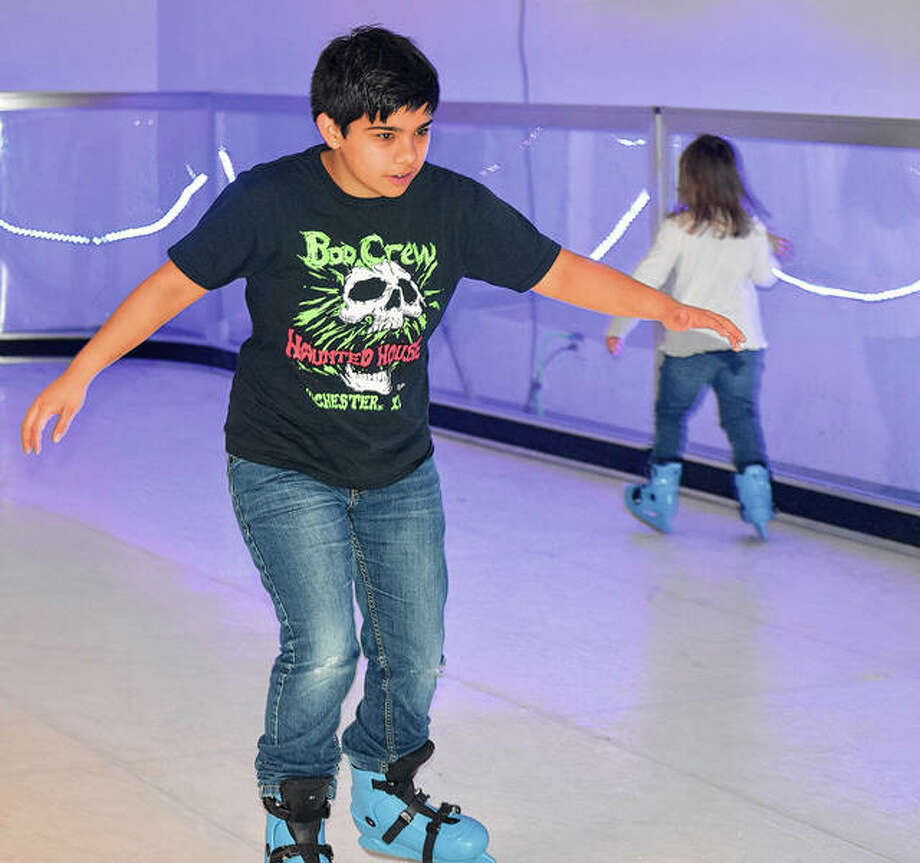 Casey Eyer, 16, of Jacksonville holds steady as he ice skates Saturday during the Community Christmas and Winter Wonderland show. Photo: Marco Cartolano | Journal-Courier
