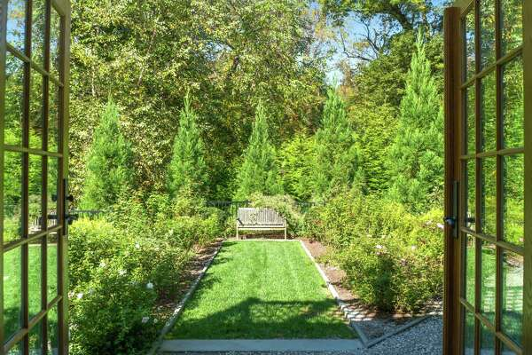 Avid gardeners, the homeowners have transformed the acreage with beautiful landscaping elements.