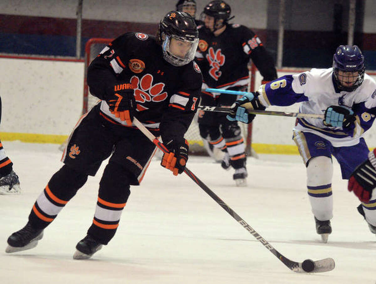 Edwardsville's Cameron Gillen controls the puck during Saturday's game againsst CBC at the Affton Ice Rink.
