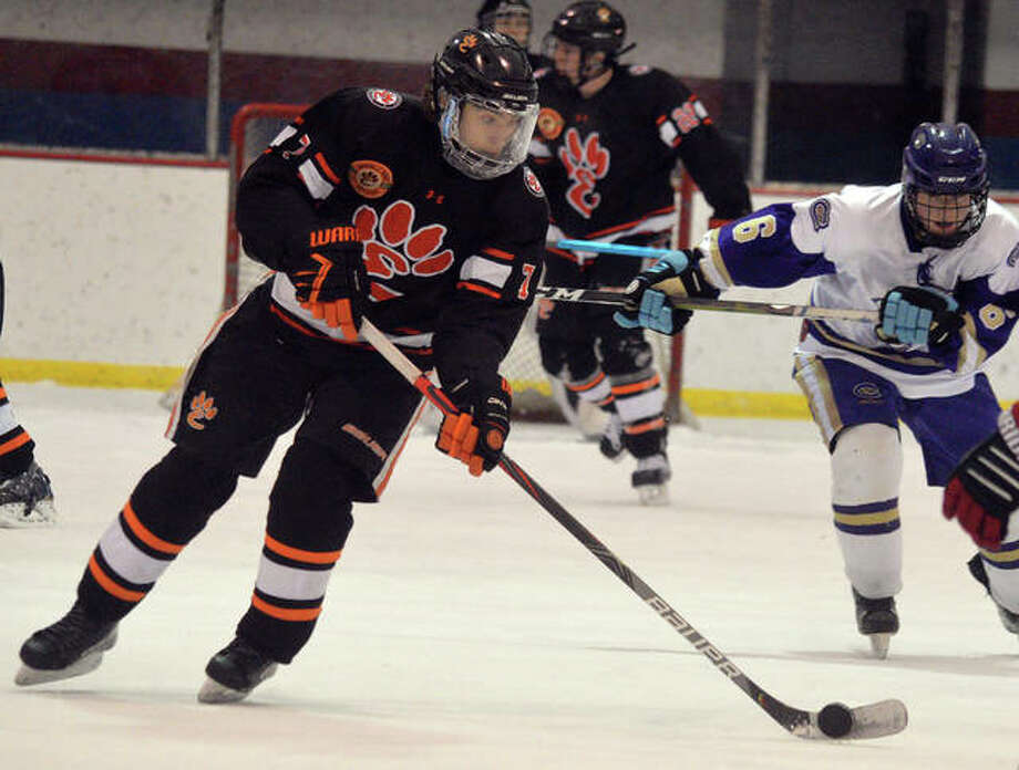 Edwardsville's Cameron Gillen controls the puck during Saturday's game againsst CBC at the Affton Ice Rink. Photo: Scott Marion/The Intelligencer