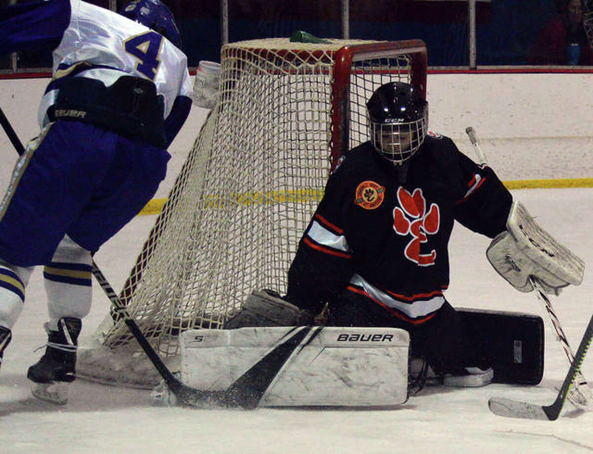 Edwardsville goalie John Paul Twombly makes a pad save on a CBC player during Saturday's game at the Affton Ice Rink.
