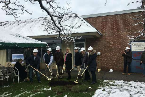 The Palmer family, town officials and project leaders broke ground on the area's redevelopment project Wednesday.