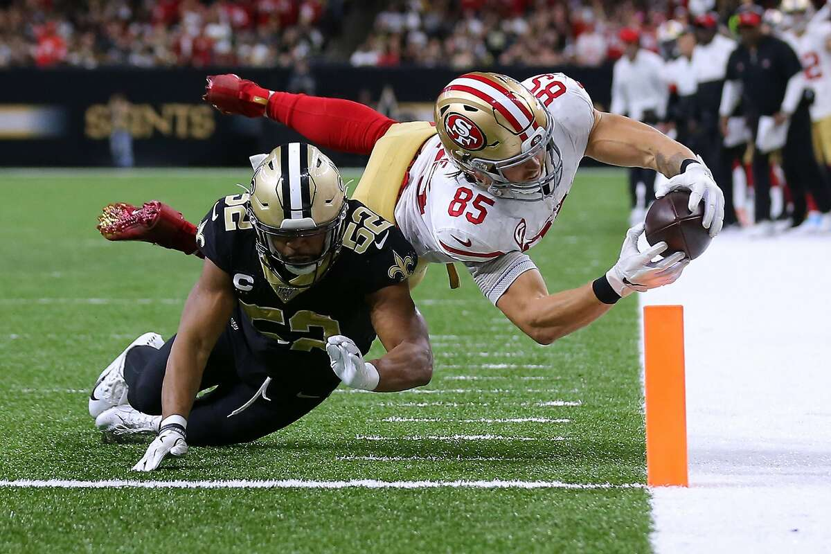 NEW ORLEANS, LOUISIANA - DECEMBER 08: George Kittle #85 of the San Francisco 49ers scores a touchdown as Craig Robertson #52 of the New Orleans Saints defends during the second half of a game at the Mercedes Benz Superdome on December 08, 2019 in New Orleans, Louisiana. (Photo by Jonathan Bachman/Getty Images) *** BESTPIX ***