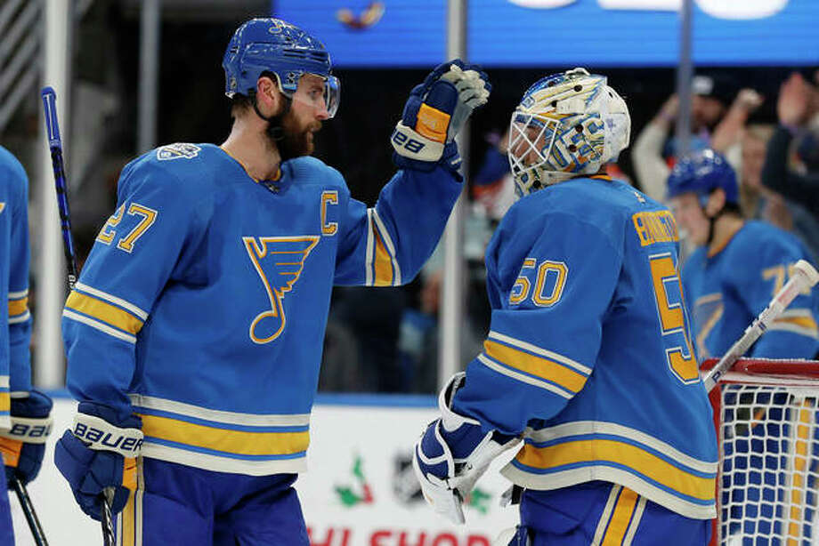 The Blues' Alex Pietrangelo (left) and goaltender Jordan Binnington celebrate a 4-3 victory over the Chicago Blackhawks on Saturday night in St. Louis.