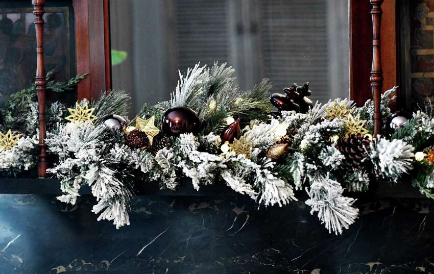 Holiday mantle decoration in the home of Stephanie Pettit on Thursday, Dec. 5, 2019, in Troy, N.Y. (Will Waldron/Times Union)
