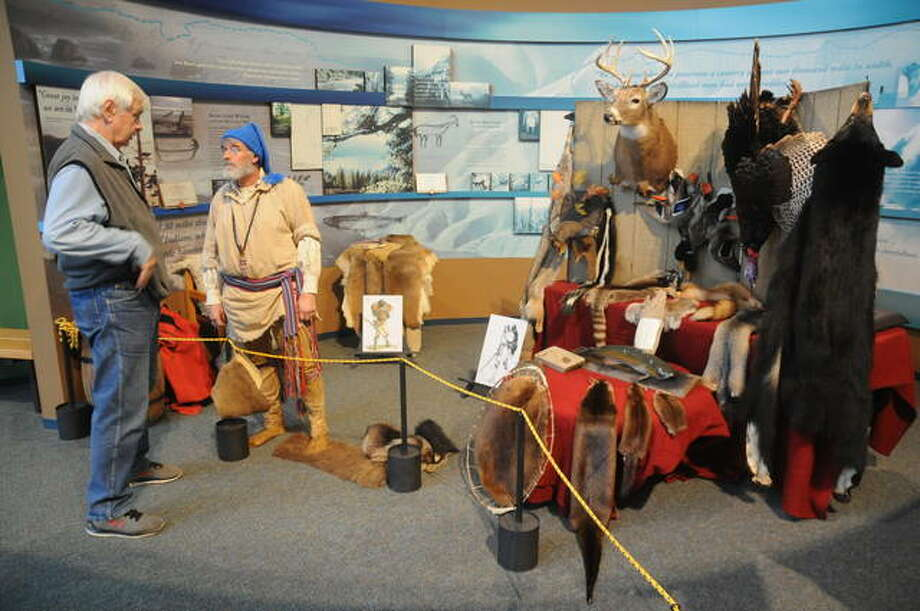 Mike Bortko of Glen Carbon discusses with re-enactor Steve Bollini of Godfrey the animals that were eaten and used for clothing on the Lewis & Clark expedition.