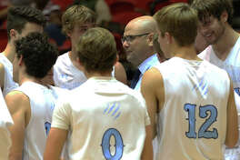 Jersey coach Stote Reeder (middle) talks with his team during a timeout in the Panthers' Nov. 25 season opener at the Centralia Tournament. The Panthers were in Pittsfield on Saturday and improved to 5-3 with a win over the Saukees.