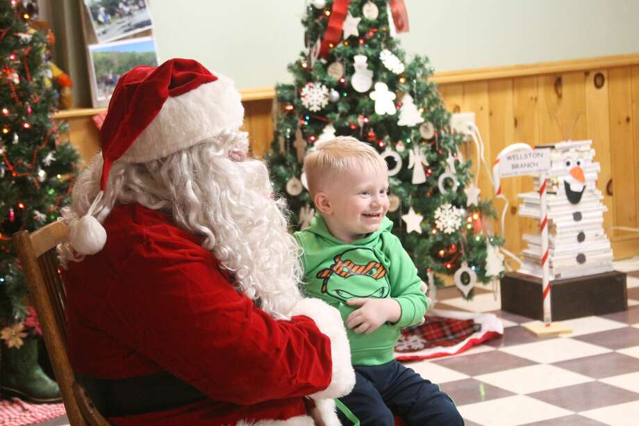 Children and parents turned out on Saturday at to see Santa at look at the Festival of Trees on Saturday at the Norman Township Hall in Wellston, hosted by the Wellston Boosters. Photo: Michelle Graves/News Advocate
