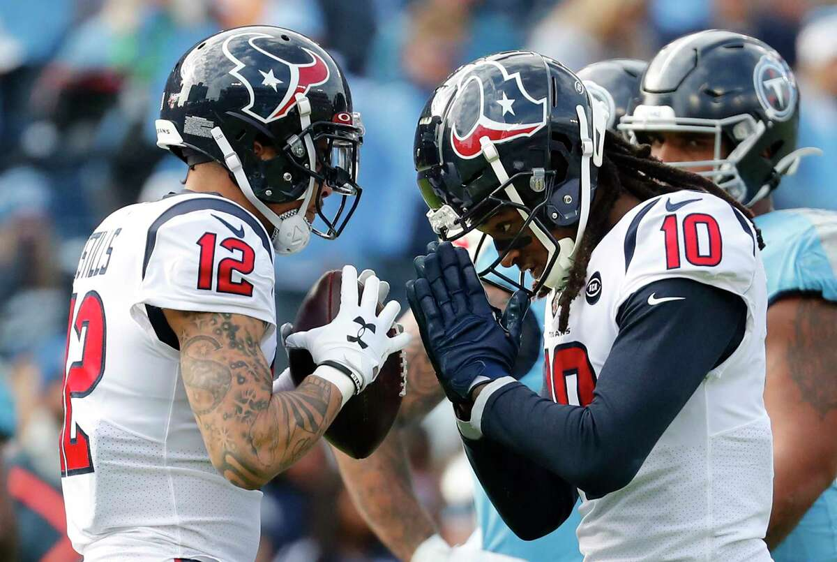 Houston Texans wide receiver Kenny Stills (12) and Houston Texans wide receiver DeAndre Hopkins (10) celebrate Stills' 16-yard touchdown reception against the Tennessee Titans during the second quarter of an NFL football game at Nissan Stadium on Sunday, Dec. 15, 2019, in Nashville.