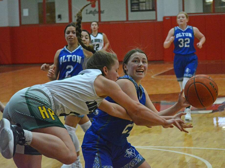 Olton's Shaylee Leathers gets fouled by a Highland Park defender during their girls basketball game in the Lady Horns Shootout on Friday afternoon at Lockney High School. Photo: Nathan Giese/Planview Herald