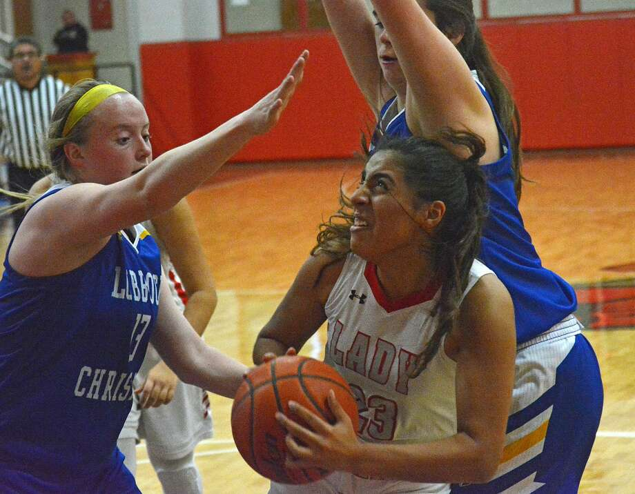 Lockney's Madai Cavira is defended by multiple Lubbock Christian defenders during their girls basketball game in the Lady Horns Shootout on Friday afternoon at Lockney High School. Photo: Nathan Giese/Planview Herald