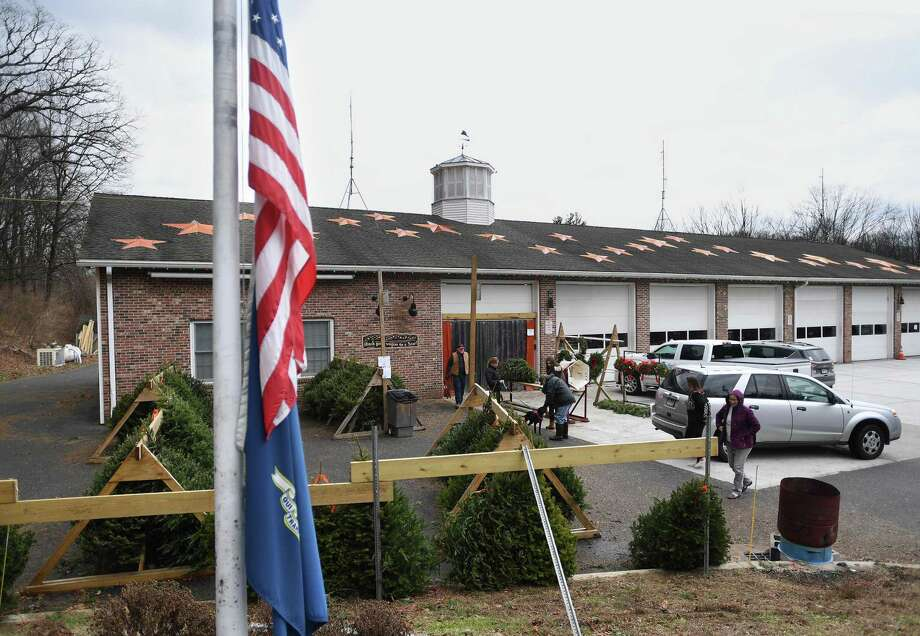 The flag flies at half staff for the seventh anniversary of the Sandy Hook mass shooting at the Sandy Hook Volunteer Fire Department in Newtown, Conn. on Sunday, December 15, 2019. The roof is adorned with twenty-six stars in honor of the victims. Photo: Brian A. Pounds / Hearst Connecticut Media / Connecticut Post