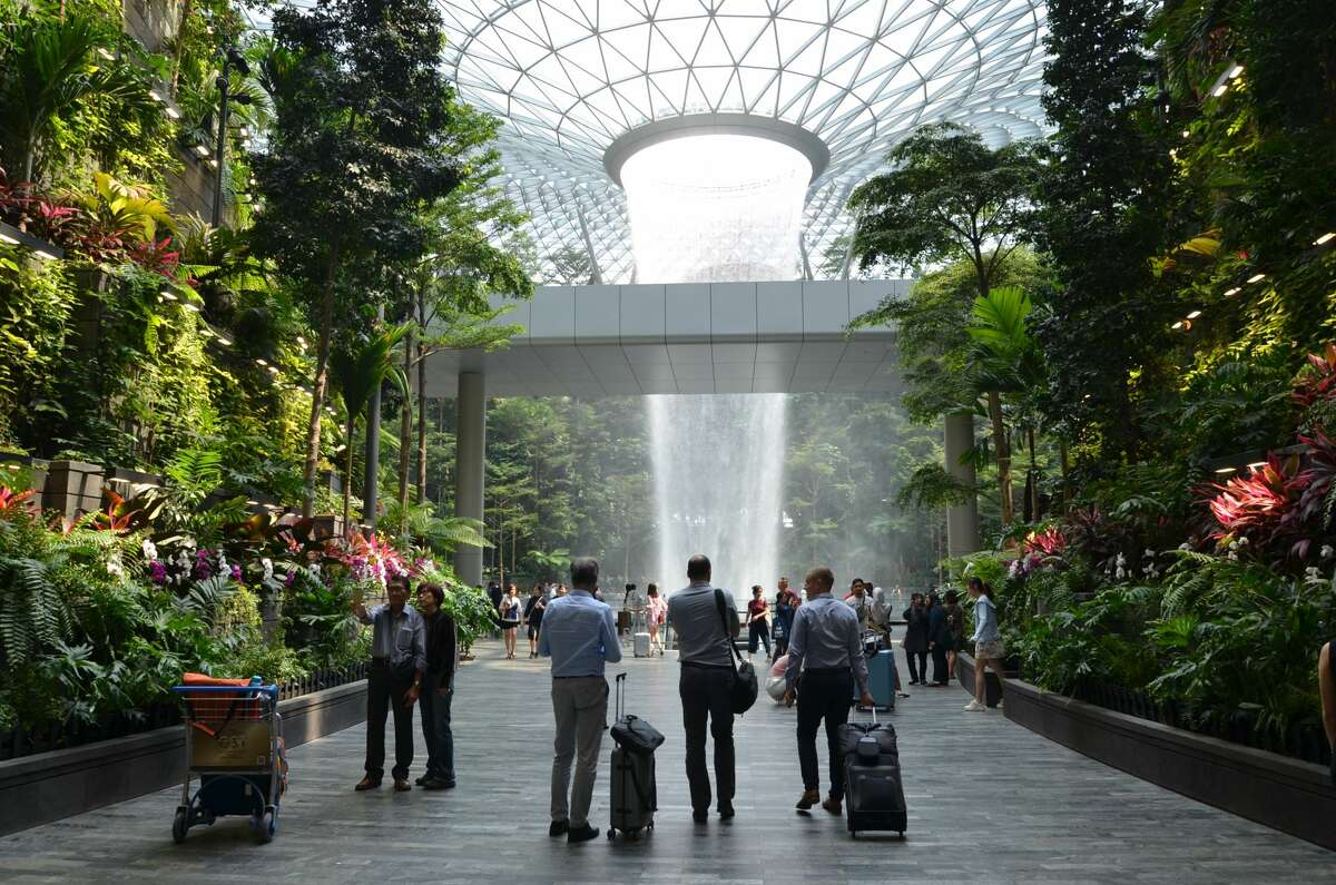 Visitors gaze at the Jewel's Rain Vortex, the largest indoor waterfall in the world.