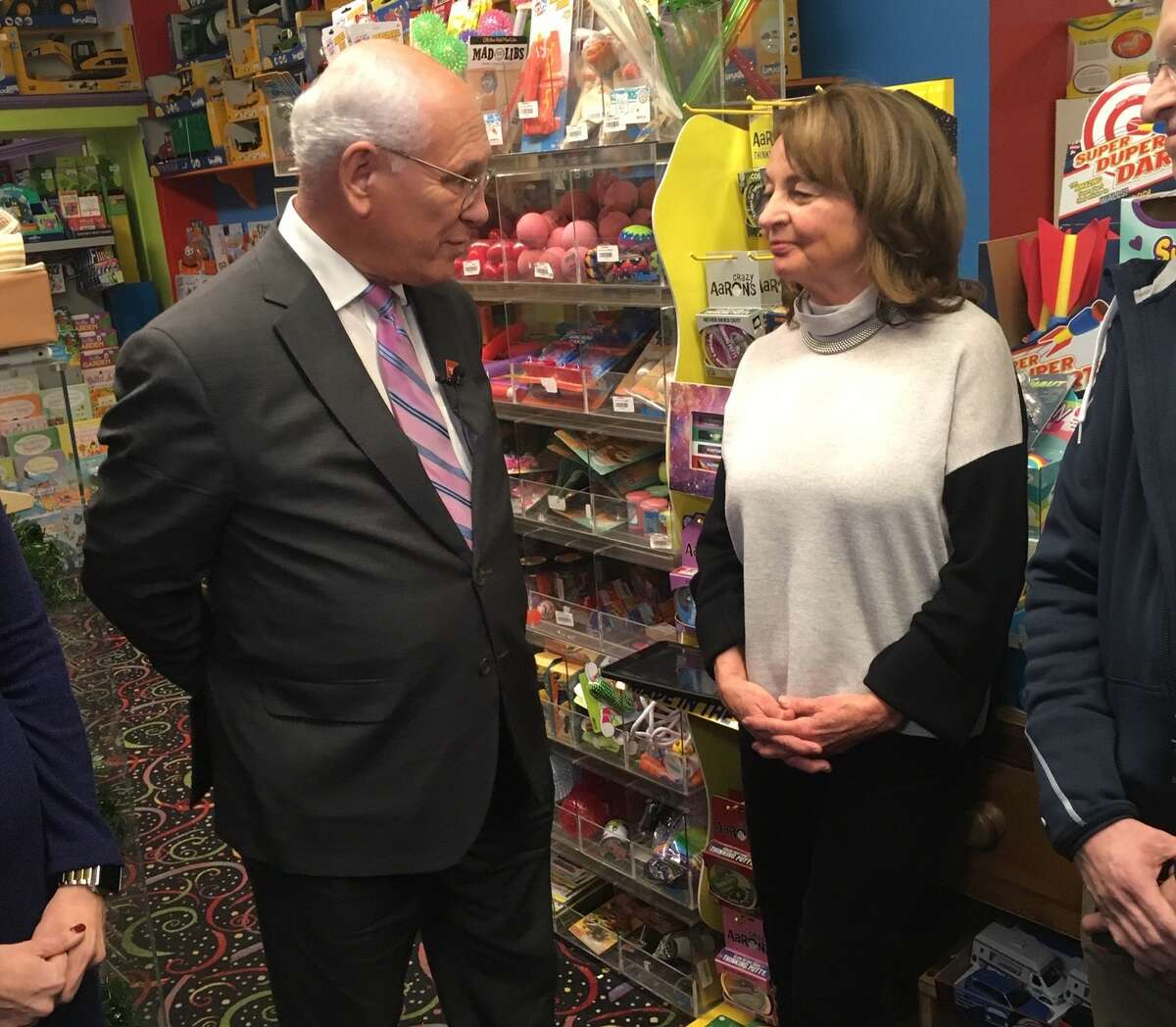 Rep. Paul Tonko (D-Amsterdam) and Linda Ambrosino, the owner of G. Willikers toy store in Saratoga Springs, talk in her store on Sunday, Dec. 15, 2019.