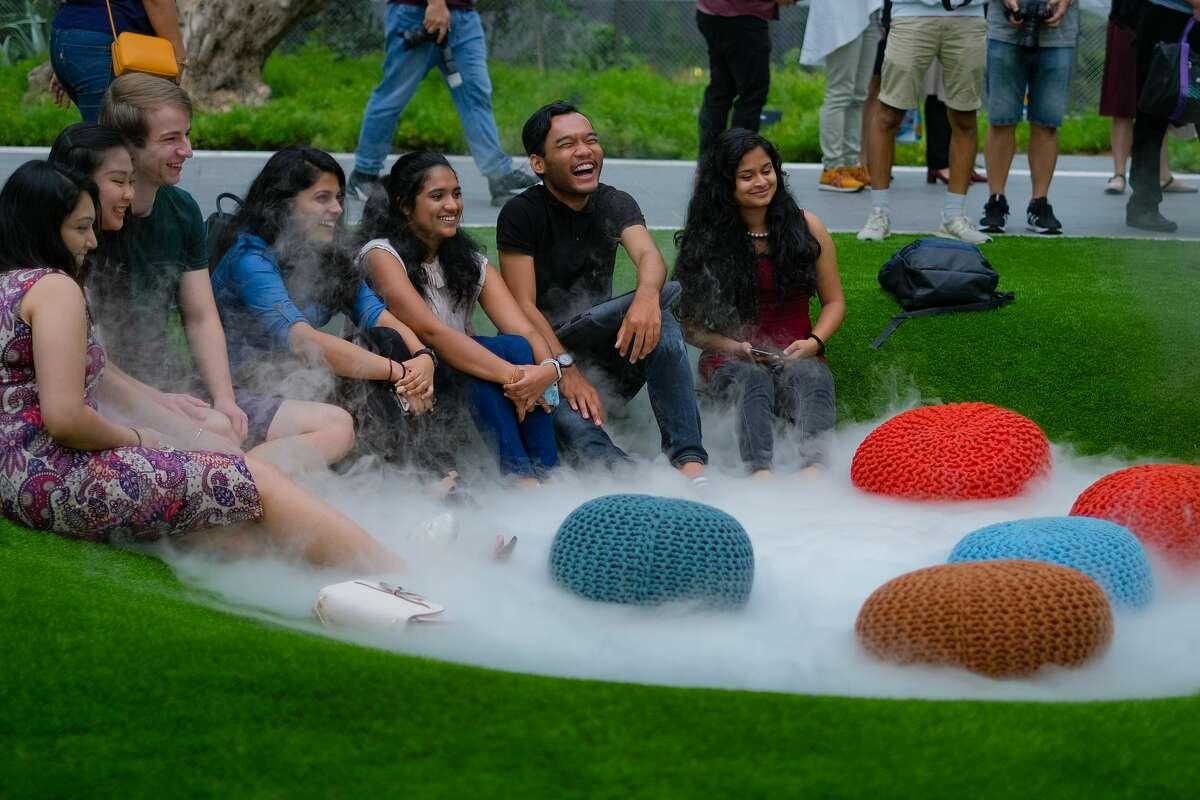 Visitors enjoy the San Francisco-fog inspired Foggy Bowl exhibit at the Jewel at Singapore's Changi Airport. (Shawn Lani Photo)