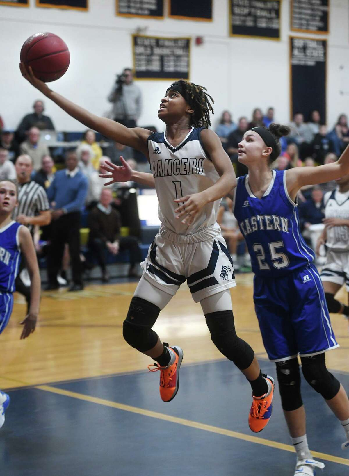 Notre Dame of Fairfield's Yamani McCollough soars to the basket ahead of Bristol Eastern defender Sage Scarritt in the first half of their CIAC Class L girls basketball quarterfinal game at Notre Dame High School in Fairfield, Conn. on Monday, March 4, 2019.