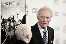 """FILE - In this Nov. 20, 2019, file photo, Clint Eastwood attends 2019 AFI Fest - """"Richard Jewell"""" at the TCL Chinese Theatre, in Los Angeles. For his film """"Richard Jewell,"""" Eastwood takes aim at the media and federal investigators for a rush to judgment after the 1996 Atlanta Olympics bombing. The 89-year-old director calls security guard Richard Jewell's story """"a great American tragedy,"""" one he's been trying to tell for five years. (Photo by Richard Shotwell/Invision/AP, File)"""