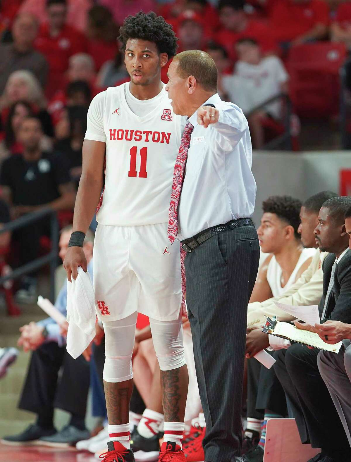 Houston Cougars head coach Kelvin Sampson gives some instruction to Houston Cougars guard Nate Hinton (11) in the first half against Oklahoma State Cowboys at Fertitta Center on Sunday, Dec. 15, 2019 in Houston.
