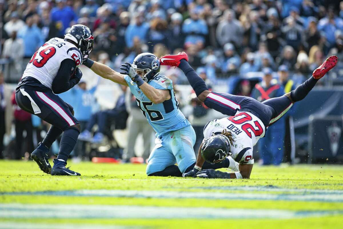 NASHVILLE, TN - DECEMBER 15: Justin Reid #20 of the Houston Texans breaks up a pass intended for Anthony Firkser #86 of the Tennessee Titans which falls into the hands of Whitney Mercilus #59 of the Houston Texans for a interception during the second quarter at Nissan Stadium on December 15, 2019 in Nashville, Tennessee.