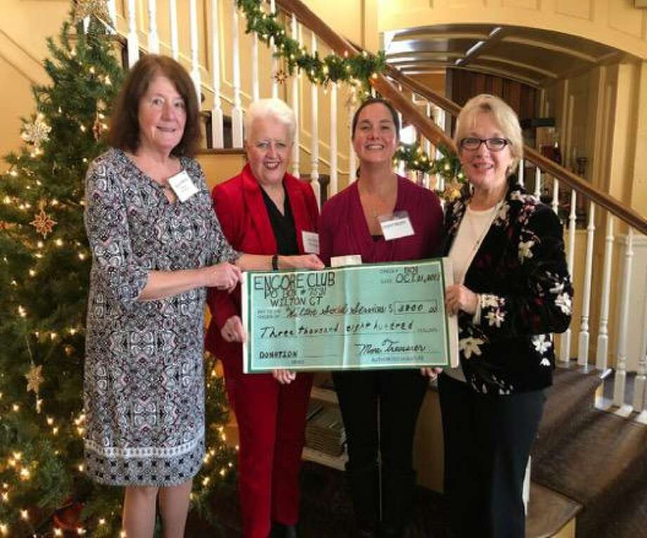 At Wilton Encore Club's annual Holiday Luncheon at Bernard's, Wilton Social Services was presented with a donation of $3,800 raised from the club's annual Fall Luncheon and Fashion show which was held in October. From left are Karen Birck, Wilton Encore Club treasurer; Kathleen Wrampe, club vice president; Sarah Heath, Wilton Social Services; and Carol Comiskey, club president. Wilton Encore Club (wiltonencoreclub.org) is a social organization for women from Wilton and surrounding areas. In April of 2020, it will celebrate its 50th anniversary. Photo: Contributed Photo / Encore Club / Wilton Bulletin Contributed