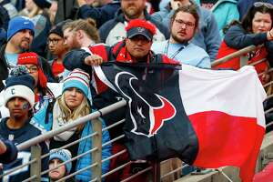 A Houston Texans fan cheers during the second quarter of an NFL football game against the Tennessee Titans at Nissan Stadium on Sunday, Dec. 15, 2019, in Nashville.