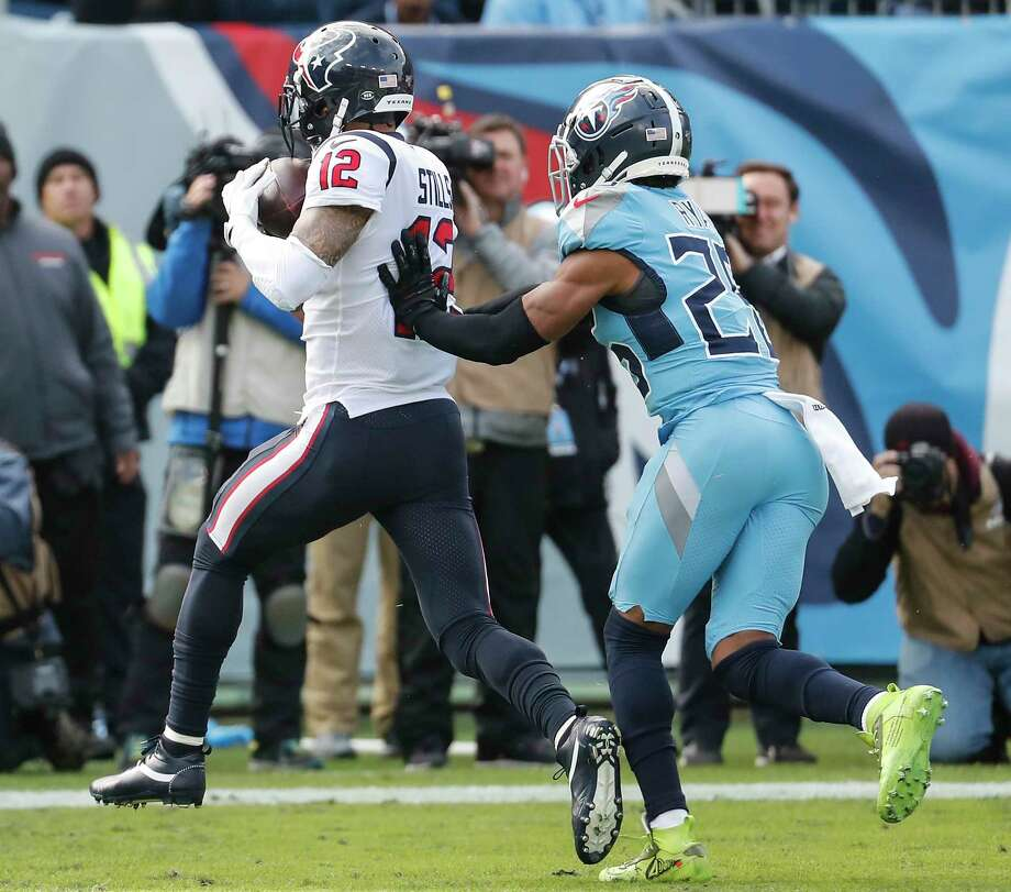 Houston Texans wide receiver Kenny Stills (12) Tennessee Titans cornerback Logan Ryan (26) as he pulls down a 12-yard during the second quarter of an NFL football game at Nissan Stadium on Sunday, Dec. 15, 2019, in Nashville. Photo: Brett Coomer, Staff Photographer / © 2019 Houston Chronicle