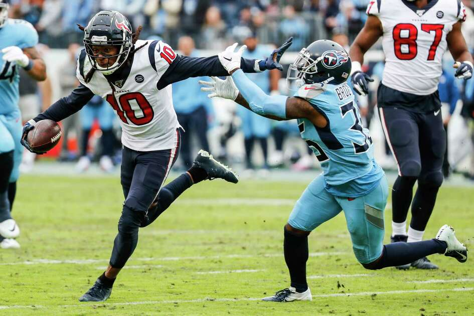 Houston Texans wide receiver DeAndre Hopkins (10) fights for yards against Tennessee Titans defensive back Tramaine Brock (35) as he makes a first down reception during the fourth quarter of an NFL football game at Nissan Stadium on Sunday, Dec. 15, 2019, in Nashville.