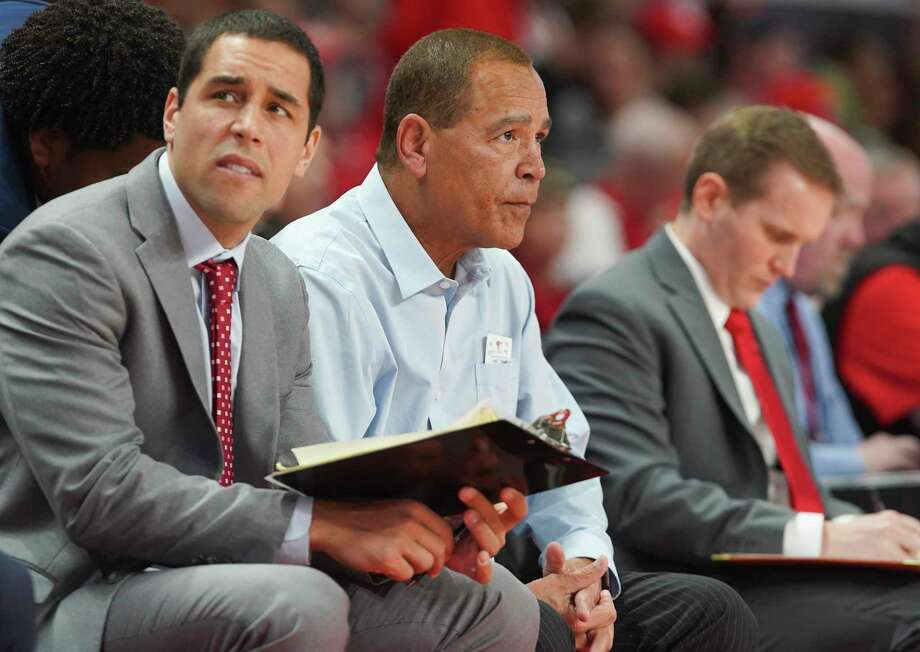 Houston Cougars assistant coach Kellen Sampson and head coach Kelvin Sampson sit on the sidelines during the second half against Oklahoma State Cowboys at the Fertitta Center on Sunday, Dec. 15, 2019 in Houston. Houston Cougars lost the game 61-55. Photo: Elizabeth Conley, Staff Photographer / © 2018 Houston Chronicle