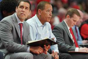Houston Cougars assistant coach Kellen Sampson and head coach Kelvin Sampson sit on the sidelines during the second half against Oklahoma State Cowboys at the Fertitta Center on Sunday, Dec. 15, 2019 in Houston. Houston Cougars lost the game 61-55.