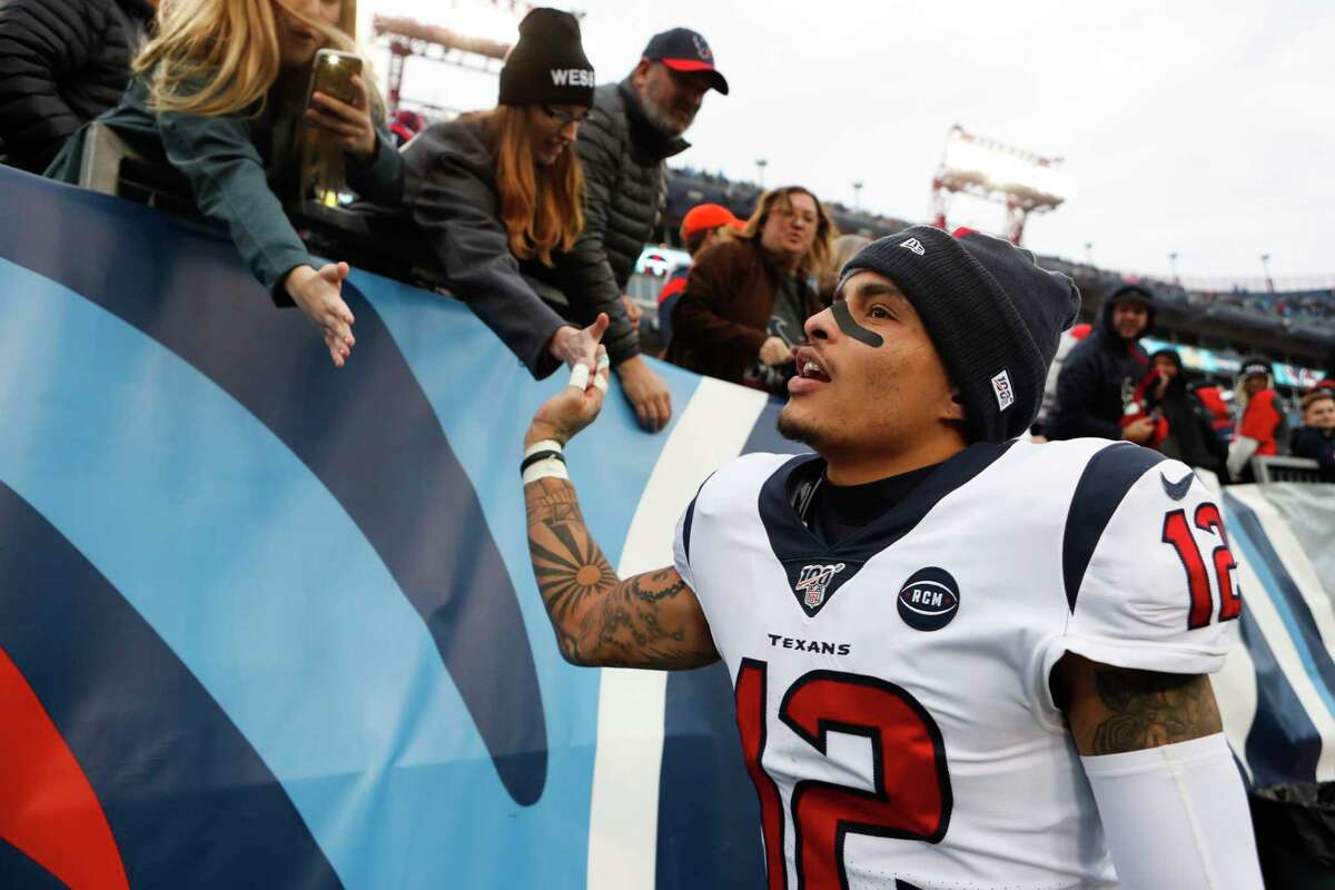 Houston Texans wide receiver Kenny Stills (12) high fives fans as he celebrates the Texans 24-21 win over the Tennessee Titans in an NFL football game at Nissan Stadium on Sunday, Dec. 15, 2019, in Nashville.