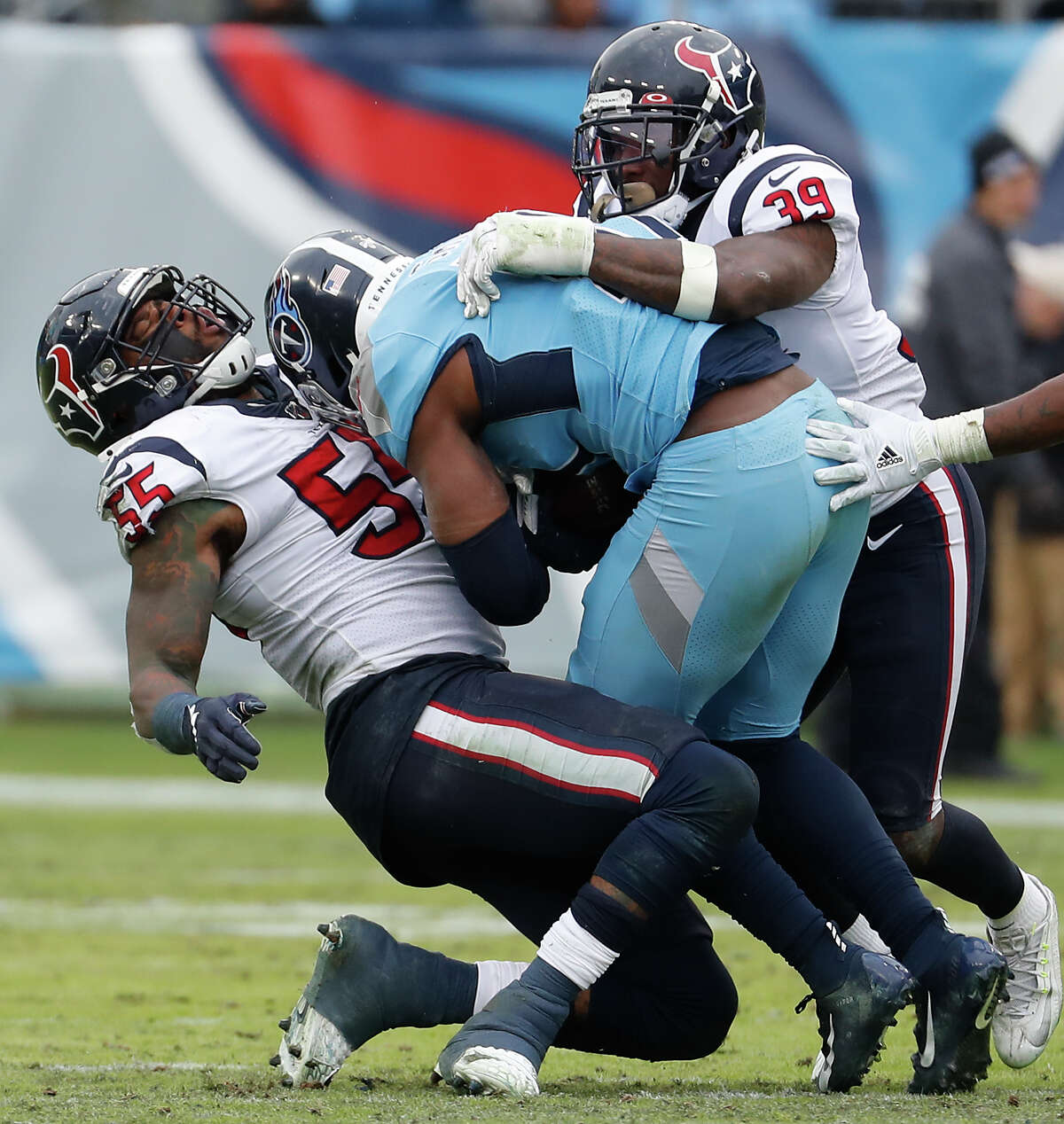 Houston Texans inside linebacker Benardrick McKinney (55) and free safety Tashaun Gipson (39) stop Tennessee Titans tight end Jonnu Smith (81) during the fourth quarter of an NFL football game at Nissan Stadium on Sunday, Dec. 15, 2019, in Nashville.
