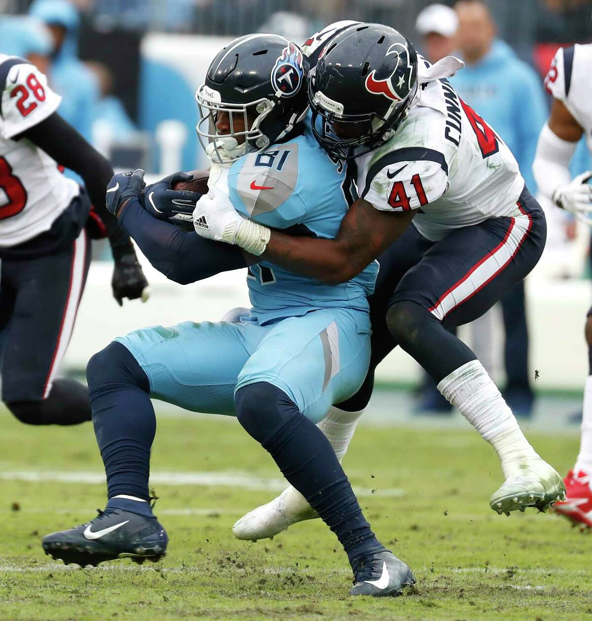 Houston Texans inside linebacker Zach Cunningham (41) stops Tennessee Titans tight end Jonnu Smith (81) during the fourth quarter of an NFL football game at Nissan Stadium on Sunday, Dec. 15, 2019, in Nashville.