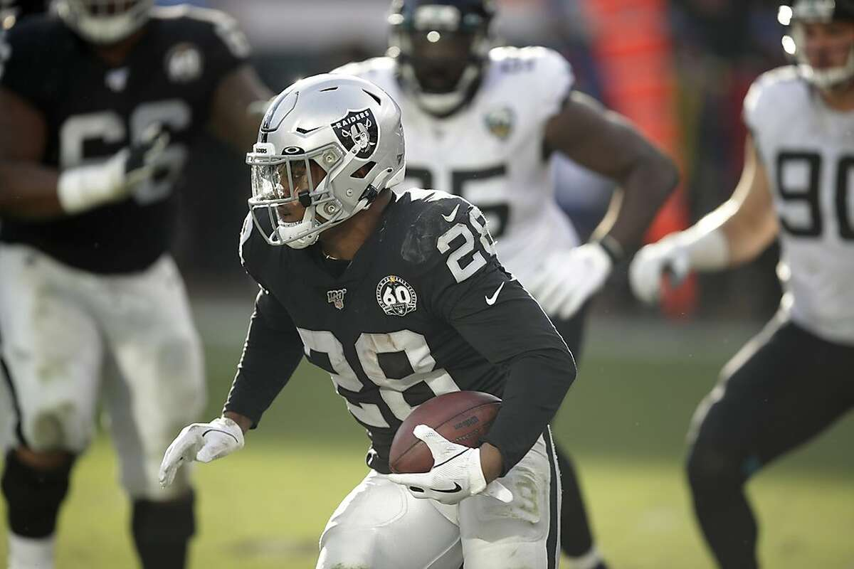 Oakland Raiders running back Josh Jacobs carries the ball during the second half of an NFL football gameagainst the Jacksonville Jaguars in Oakland, Calif., Sunday, Dec. 15, 2019. (AP Photo/Ben Margot)