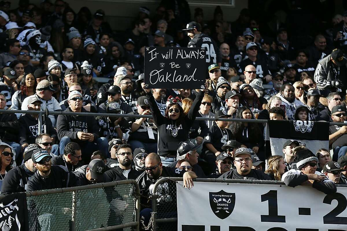 Oakland Raiders fans during the second half of an NFL football game against the Jacksonville Jaguars in Oakland, Calif., Sunday, Dec. 15, 2019. (AP Photo/D. Ross Cameron)