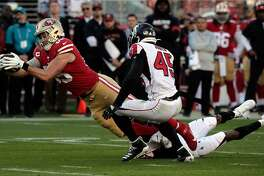 George Kittle (85) stretches for extra yards after a catch in the first half as the San Francisco 49ers played the Atlanta Falcons at Levi's Stadium in Santa Clara, Calif., on Sunday, December 15, 2019.