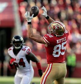 George Kittle (85) makes a catch on a pass from Jimmy Garoppolo (10) in the red zone in the first half as the San Francisco 49ers played the Atlanta Falcons at Levi's Stadium in Santa Clara, Calif., on Sunday, December 15, 2019.