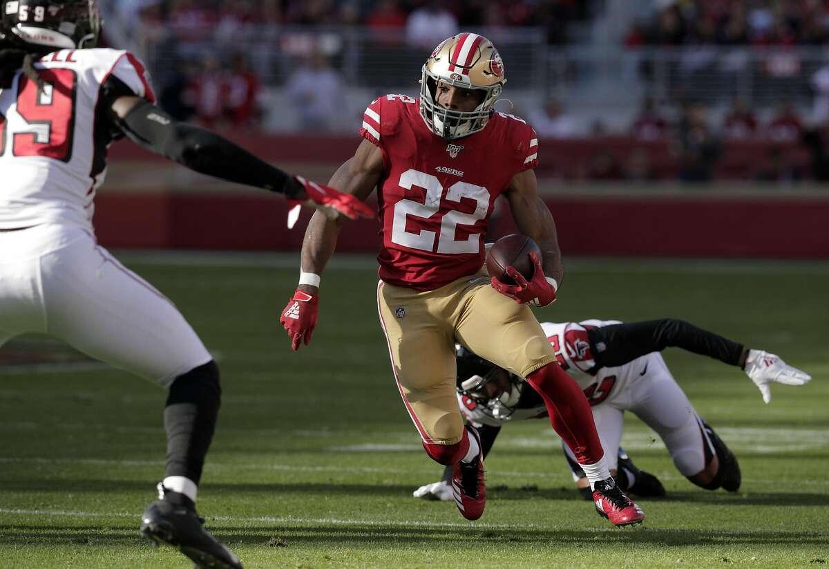 Matt Breida (22) runs after evading a defender In the first half as the San Francisco 49ers played the Atlanta Falcons at Levi's Stadium in Santa Clara, Calif., on Sunday, December 15, 2019.
