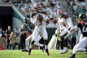 Tampa Bay Buccaneers quarterback Jameis Winston (3) sets up to throw a pass during the second half of an NFL football game against the Jacksonville Jaguars Sunday, Dec. 1, 2019, in Jacksonville, Fla. (AP Photo/Phelan M. Ebenhack)