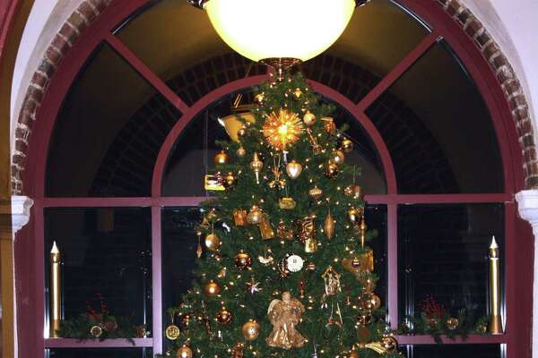 A nine-foot tree at the entrance to the Convent of Mercy on New Scotland Avenue in Albany carries a 40-year collection of ornaments. (Sister Barbara Roman, RSM)