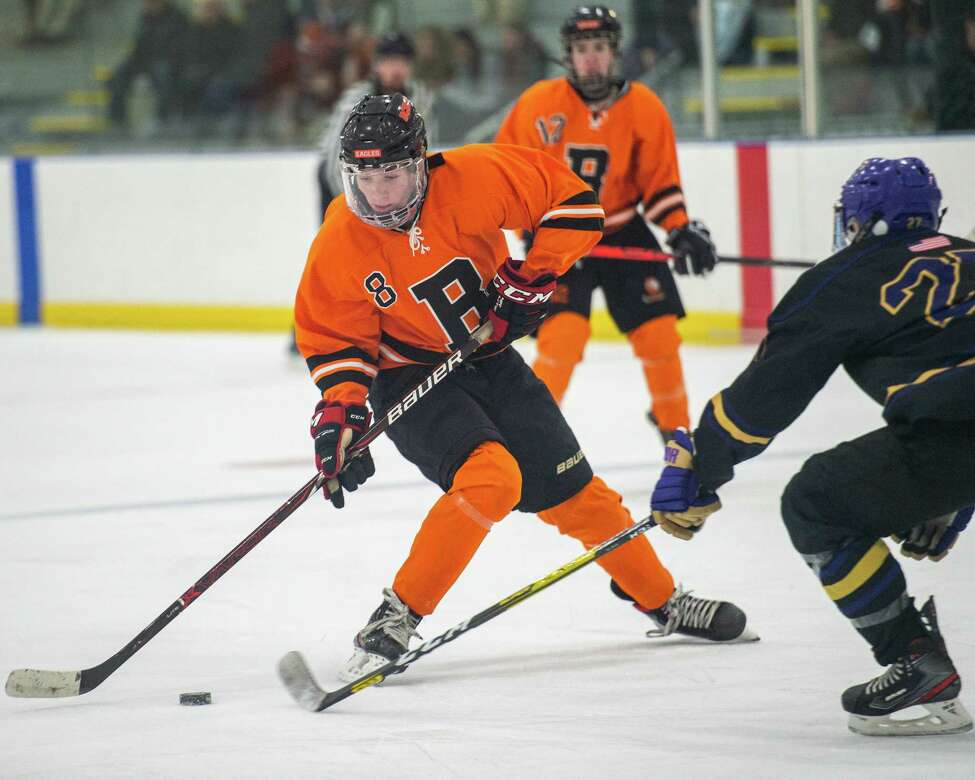 Bethlehem forward Jackson Carroll takes a shot in front of CBA defender Colin Mesick during the Capital District High School Hockey League opener for both teams at the Albany County Hockey Facility in Colonie on Friday, Dec. 13, 2019 (Jim Franco/Special to the Times Union.)