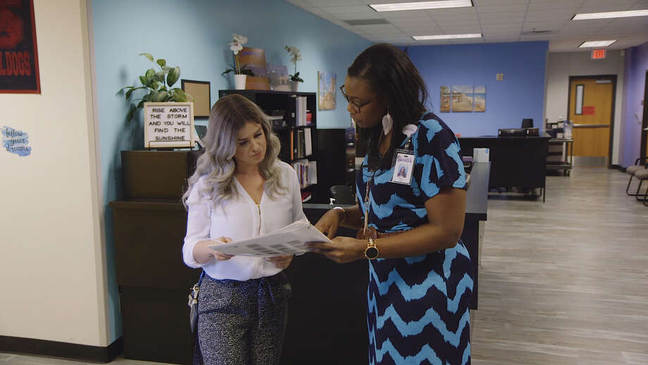 Ashland Pingue, assistant principal at Legacy Middle School, discusses the daily activities with principal Nicole Thomas. Pingue moved from North Carolina to work for East Central ISD. Photo: East Central ISD