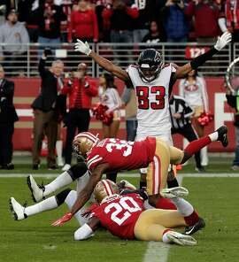 Russell Gage (83) gestures touchdown as Julio Jones (11) falls near the goal line late in the second half as the San Francisco 49ers played the Atlanta Falcons at Levi's Stadium in Santa Clara, Calif., on Sunday, December 15, 2019. The play was deemed a touchdown after a review in the final seconds.