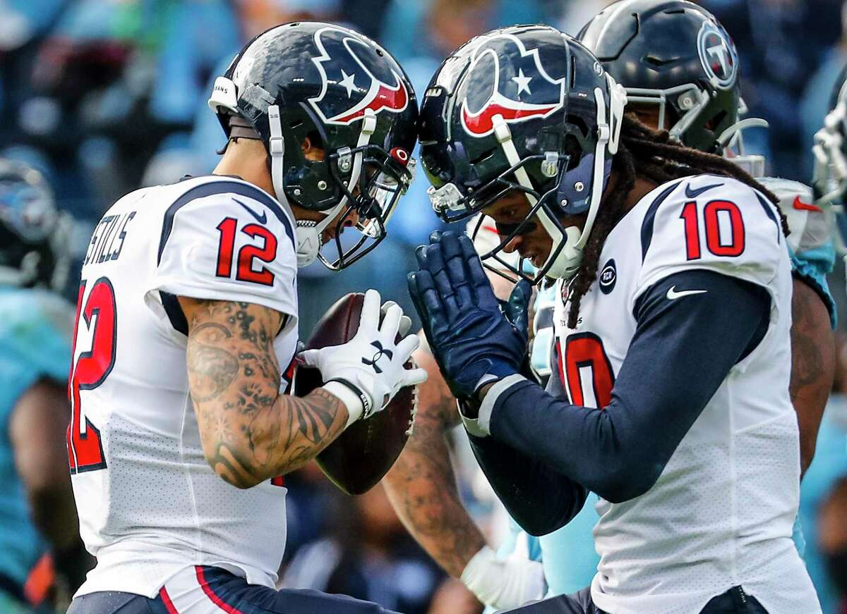Kenny Stills (12) and DeAndre Hopkins played big roles in the Texans' 24-21 victory over the Titans on Sunday. Stills caught a pair of first-half touchdown passes, and Hopkins totaled 119 yards receiving.