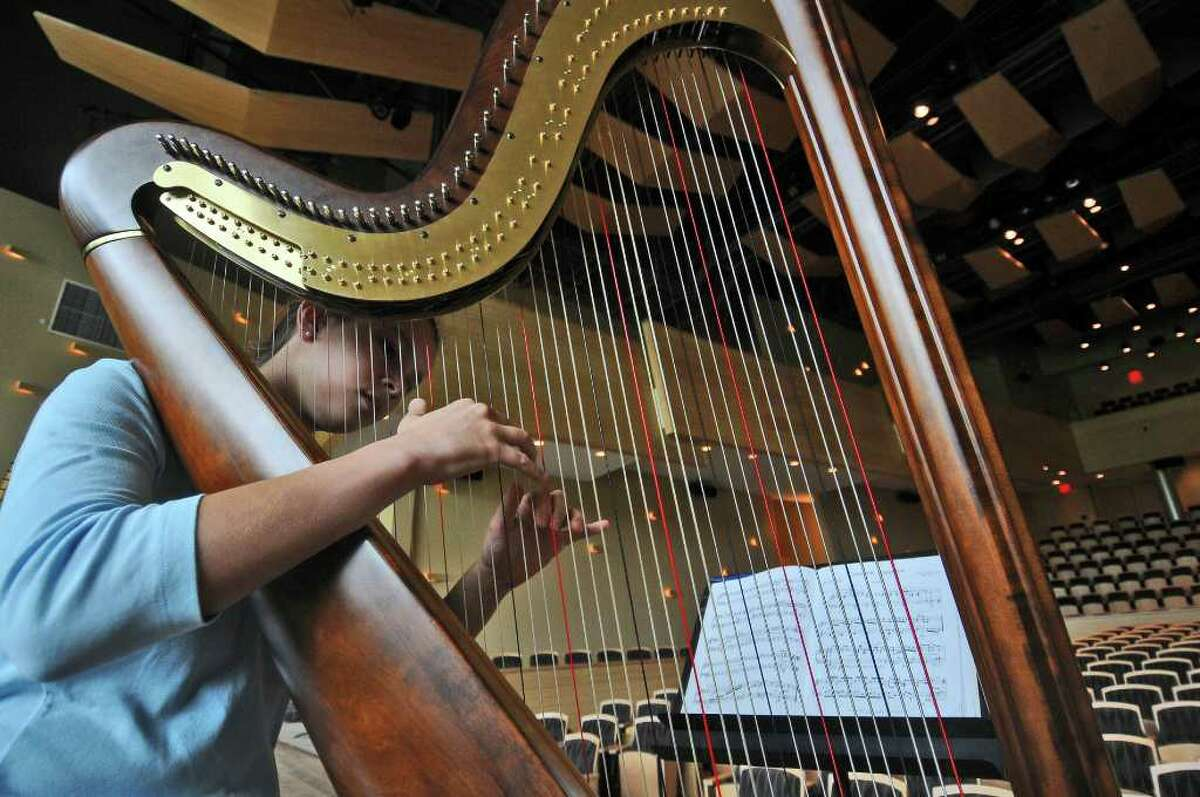 Katie Karpelsohn of Bloomington, Indiana, 14, rehearses with the ensemble of the Harp Colony during a dress rehearsal on Sunday August 8, 2010 at Skidmore College in Saratoga Springs, NY for a performance that afternoon. The Harp Colony is a gathering of harp players and students that has been going on at Skidmore during August and is now in its sixth year there. (The colony is under the direction of Philadelphia Orchestra harpist Elizabeth Hanien, who was not present at the dress rehearsal). ( Philip Kamrass / Times Union )