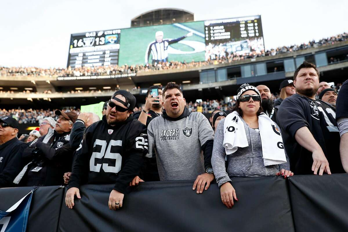 Oakland Raiders' fans react to a roughing the passer penalty in final minute of Jacksonville Jaguars' 20-16 win during Raiders' final game at Oakland Coliseum in Oakland, Calif., on Sunday, December 15, 2019.
