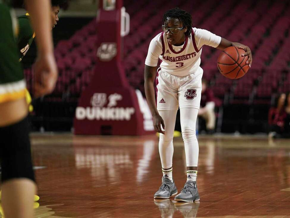 Destiney Philoxy, right, looks to pass against Siena's Rayshel Brown, left. Philoxy had 10 points and 5 assists for UMass. (Photo by Chris Tucci, UMass Athletics)